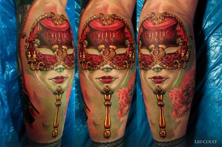 Realism style colored leg tattoo of cool looking mask with flowers