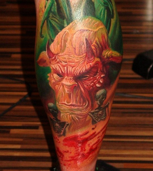 Realism style colored leg tattoo of devil face with skeleton