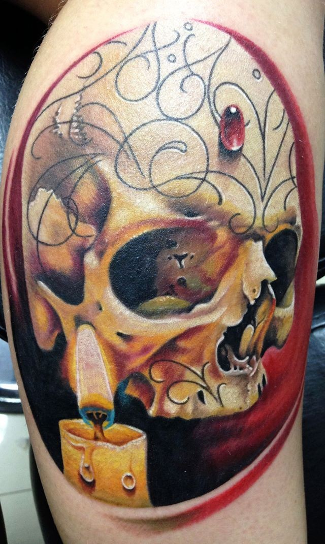 Realism style colored leg tattoo of human skull with candle and jewelry