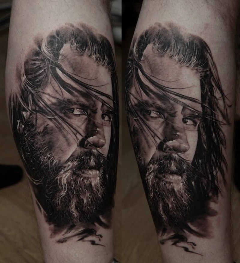 Realism style colored leg tattoo of man portrait