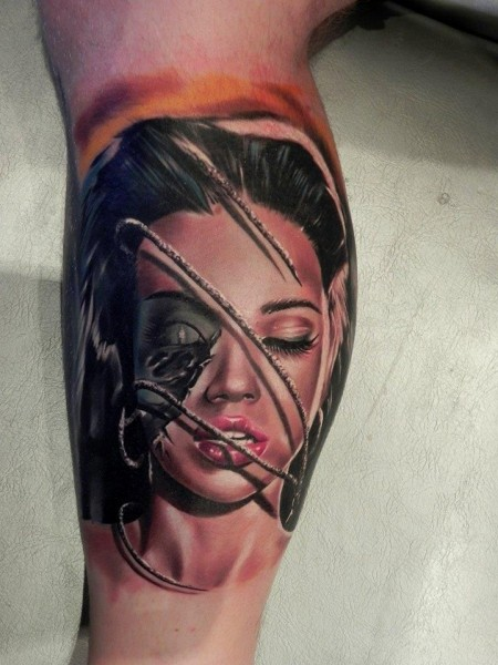 Realism style colored leg tattoo of woman face with rope