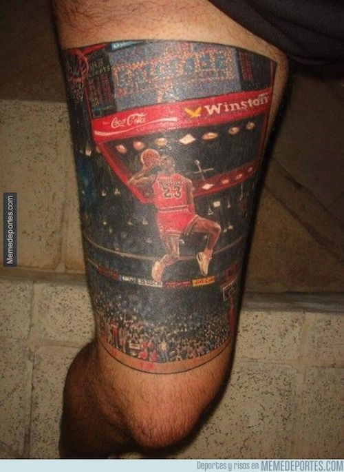 Realism style colored Michael Jordan tattoo on thigh