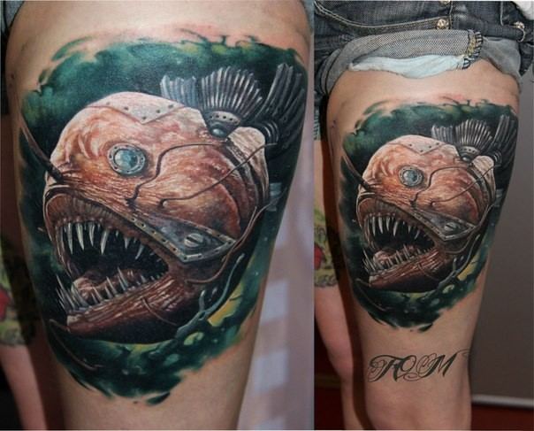 Realism style colored mystical thigh tattoo of biomechanical evil fish