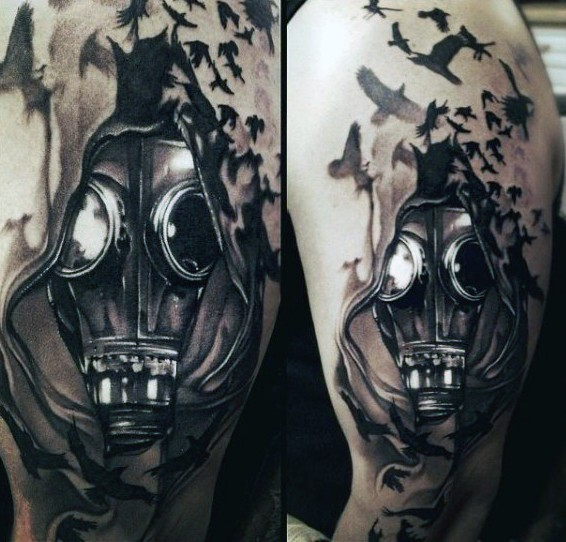 Realism style colored shoulder tattoo of man with gas mask