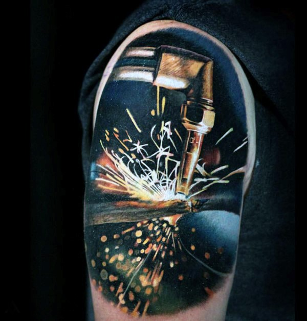 Realism style colored shoulder tattoo of welding works