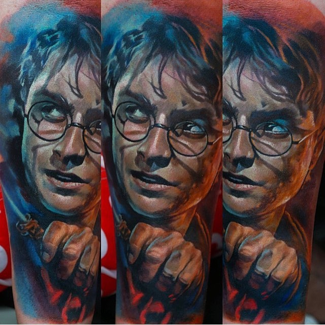 Realism style colored shoulder tattoo of Harry Potter portrait