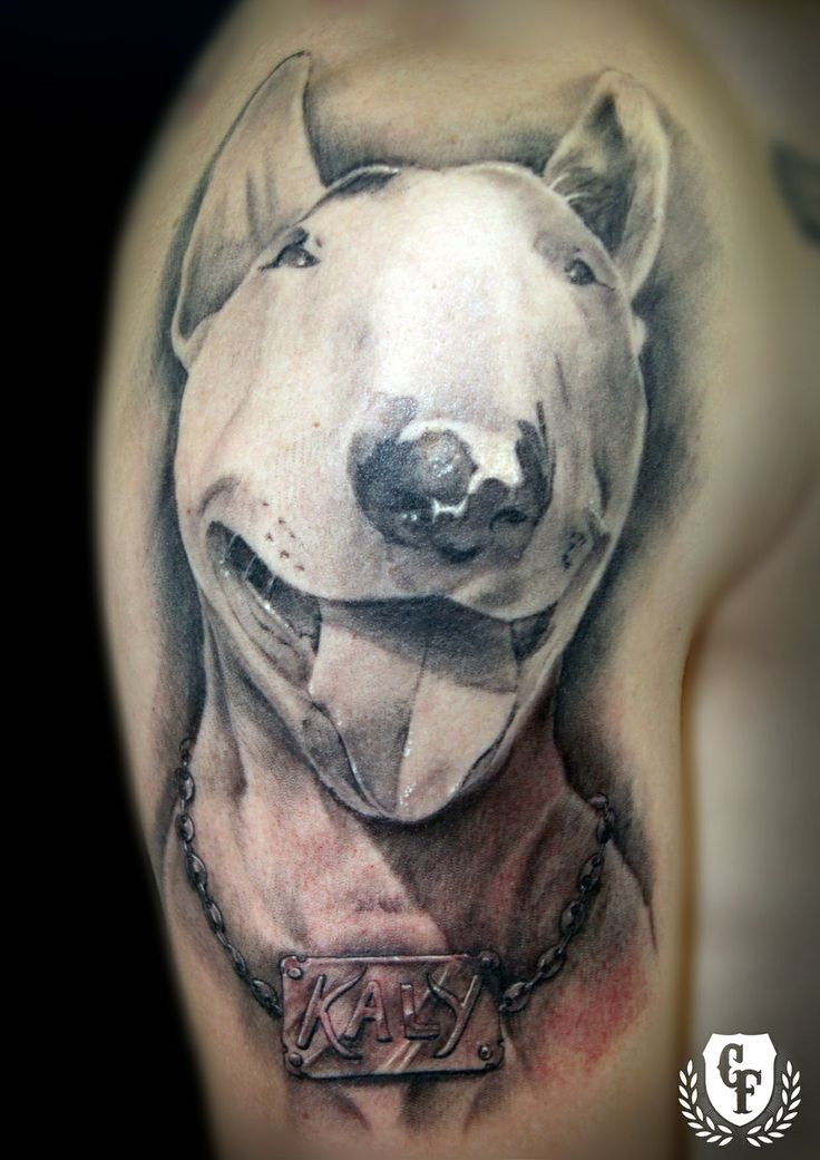 Realism style colored shoulder tattoo of dog portrait with lettering
