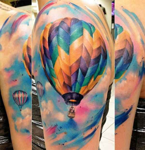 Realism style colored shoulder tattoo of flying balloon