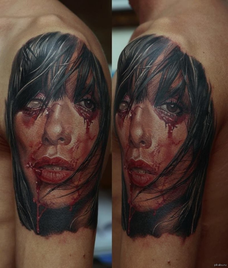 Realism style colored shoulder tattoo of bloody demonic woman face