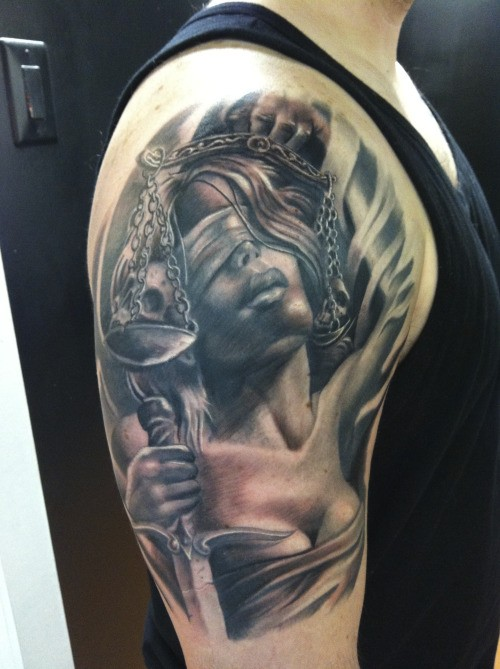 Realism style colored shoulder tattoo of Justice woman