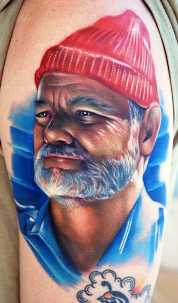 Realism style colored shoulder tattoo of old man with beard