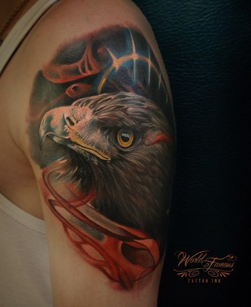 Realism style colored shoulder tattoo of eagle head