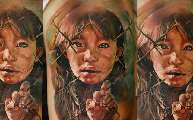 Realism style colored shoulder tattoo of small girl behind the fence