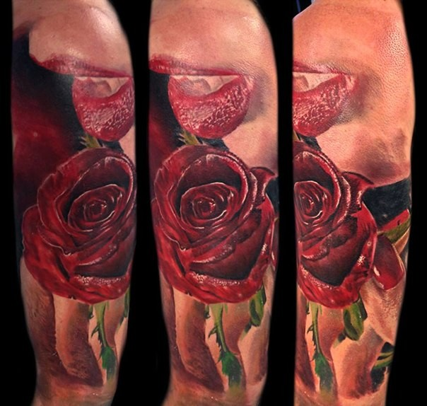 Realism style colored shoulder tattoo of red rose with vampire mouth