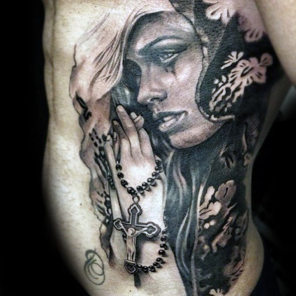 Realism style colored side tattoo of praying woman with cross