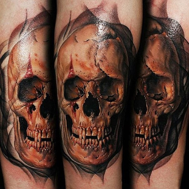 Realism style colored tattoo of bloody ancient skull