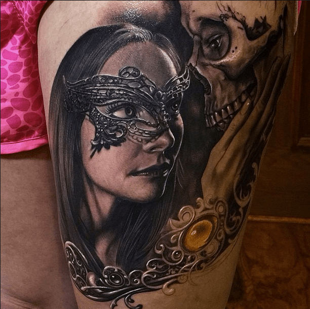Realism style colored tattoo of woman with mask and human skull