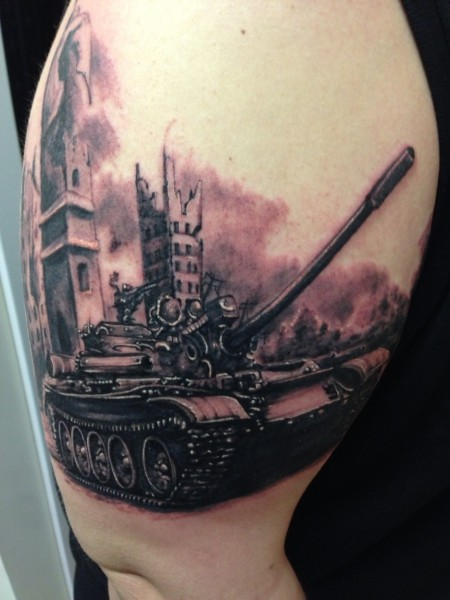 Realism style colored thigh tattoo of modern tank