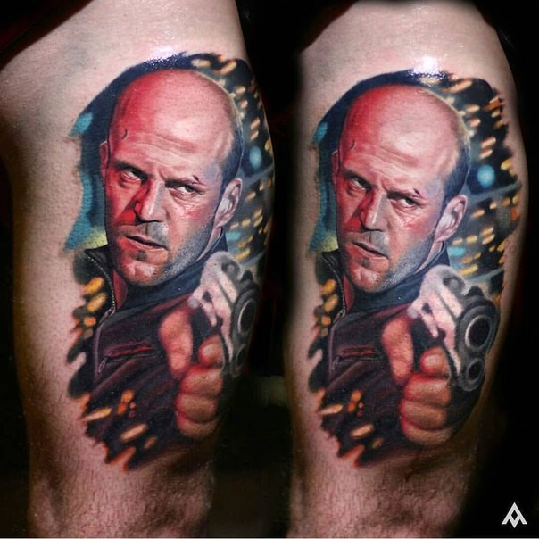 Realism style colored thigh tattoo of famous actor with pistol