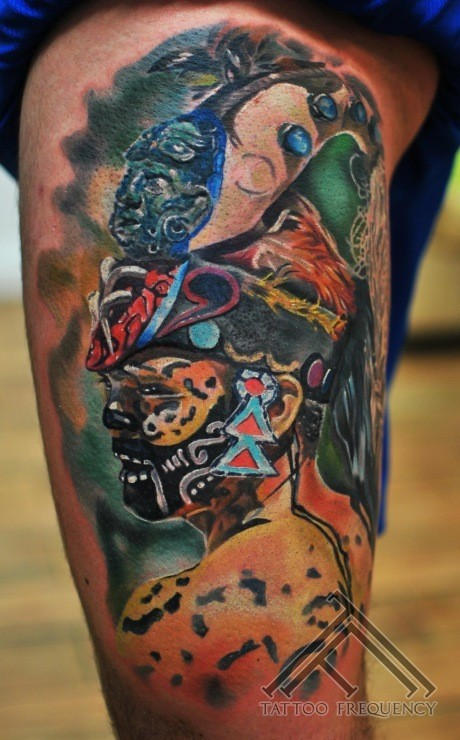 Realism style colored tribal shaman tattoo on thigh