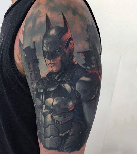 Realism style colored very detailed cool looking Batman tattoo on upper arm
