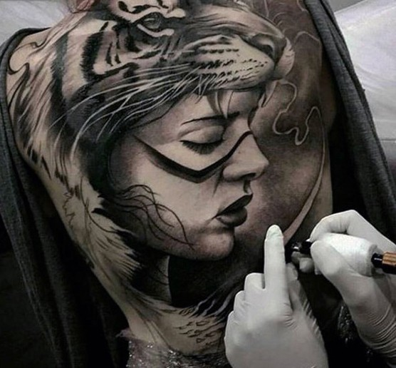 Realism style colored whole back tattoo of woman with tiger helmet