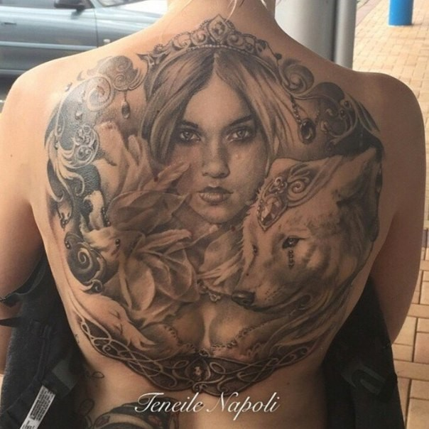 Realism style colored whole back tattoo of mystical woman with wolf and flowers