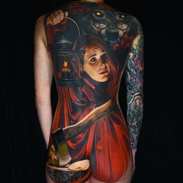 Realism style colored whole back tattoo of creepy woman with axe and wolf with old lighter