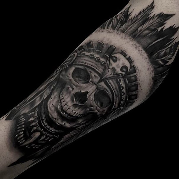 Realism style detailed arm tattoo of Indian skull with feather