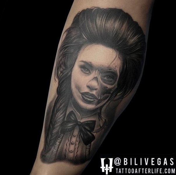 Realism style detailed black and white leg tattoo of woman stylized with skull
