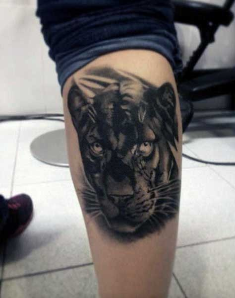 Realism style detailed black panther tattoo on leg muscle