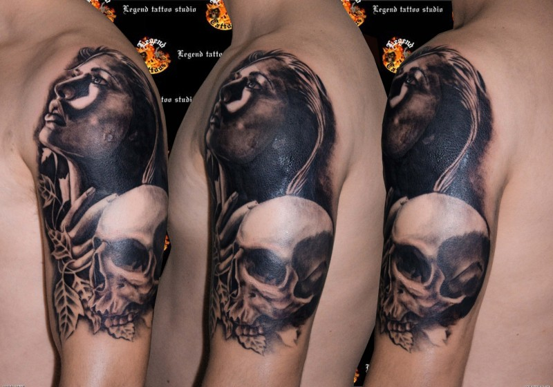 Realism style detailed shoulder tattoo of woman with human skull and leaves