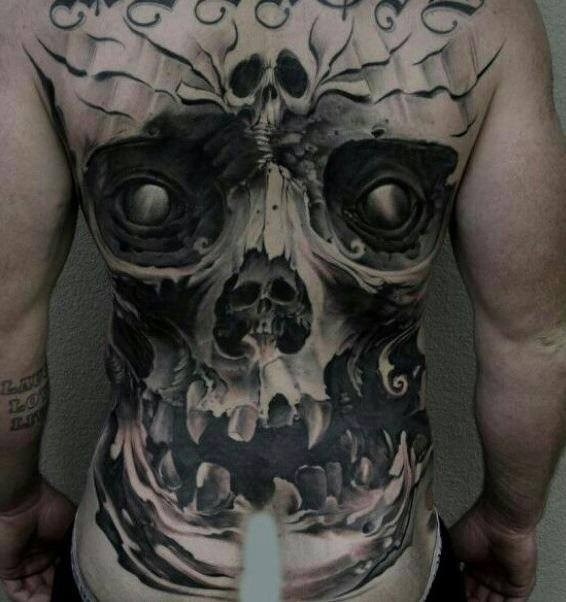 Realism style large whole back tattoo of human like demonic skull