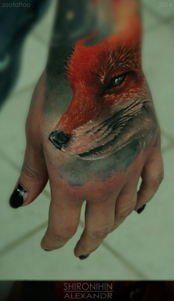 Realism style lifelike colored hand tattoo of smiling fox