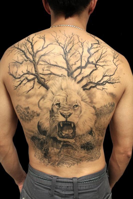 Realism style lifelike whole back tatto of desert tree with roaring lion