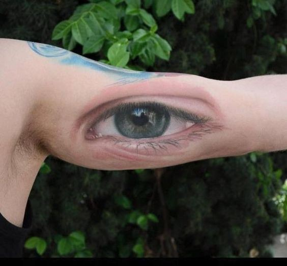 Realism style very detailed biceps tattoo of human eye