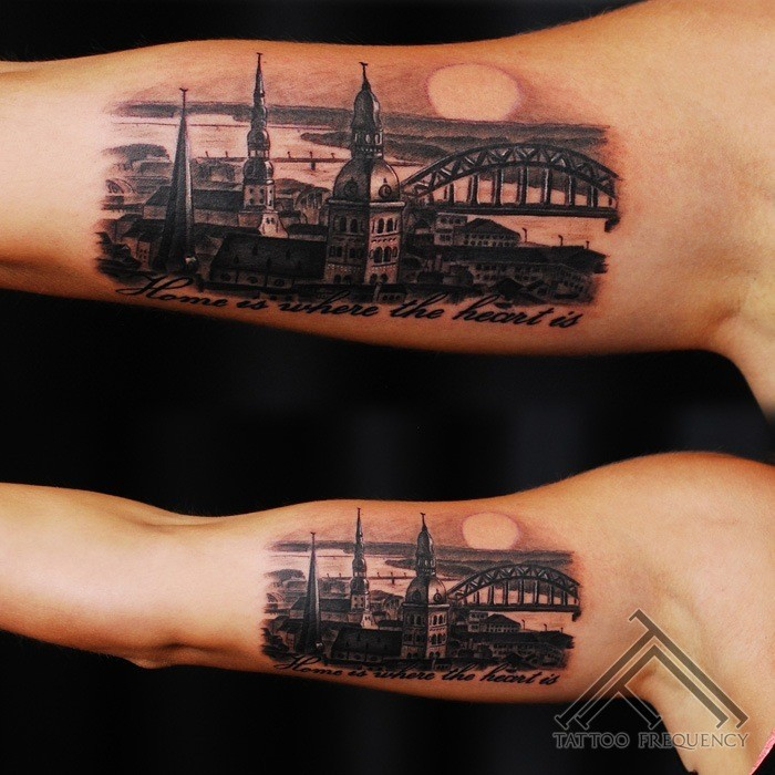 Realism style very detailed biceps tattoo of old city sights