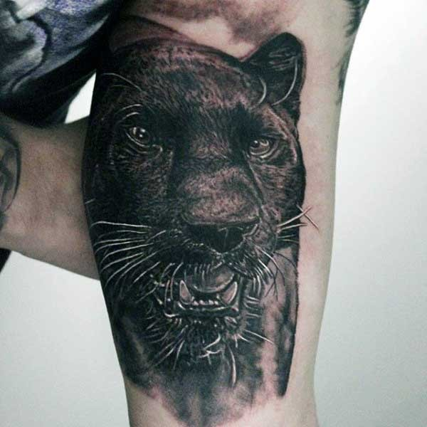 Realism style very detailed black panther tattoo on biceps