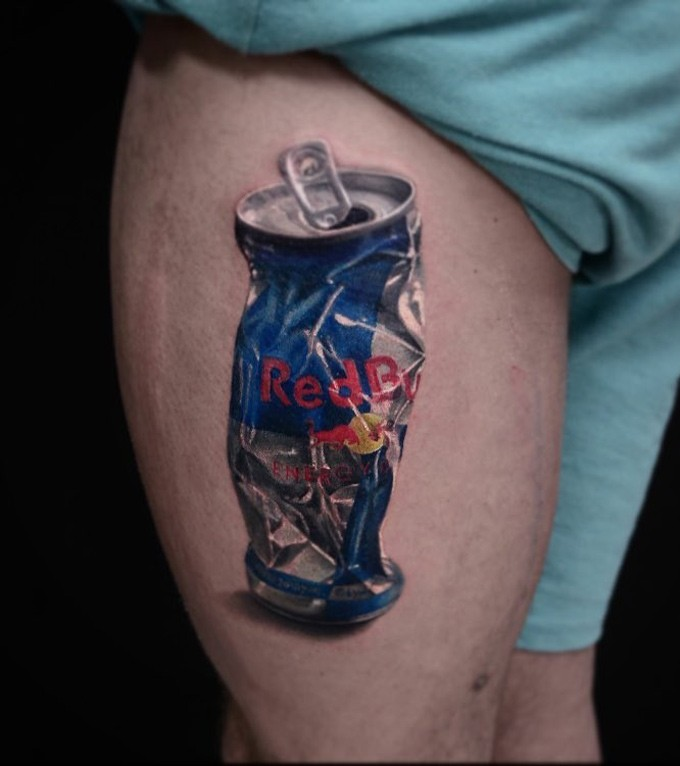 Realism style very detailed colored thigh tattoo of smashed Red Bull can