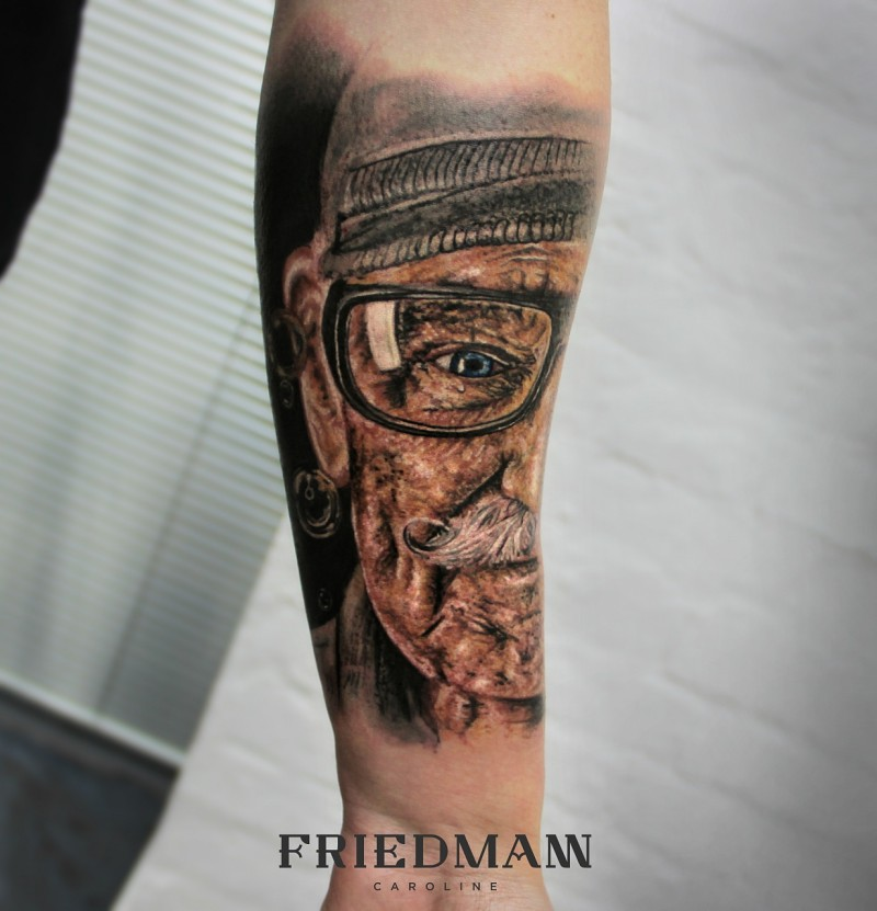 Realism style very detailed forearm tattoo of old man portrait