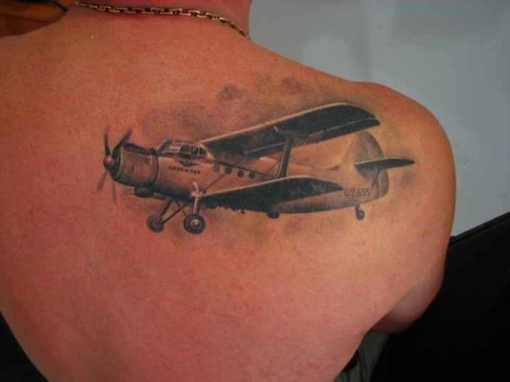 Realism style very detailed scapular tattoo of vintage plane