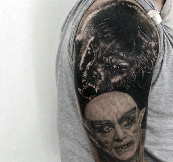 Realism style very detailed shoulder tattoo of werewolf and vampire