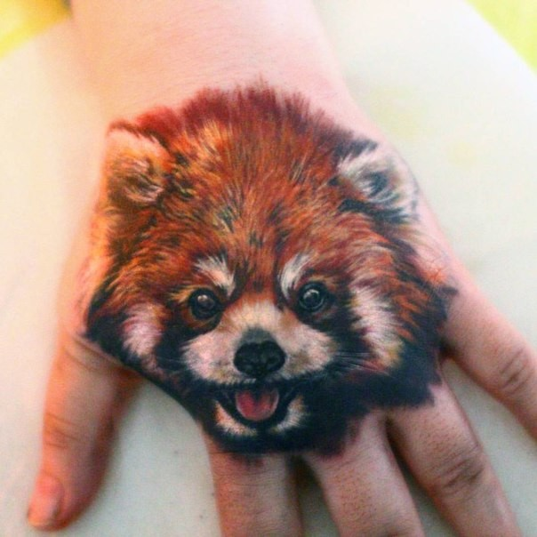Realism style very detailed small dog portrait tattoo on hand