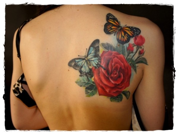Realist multicolored nature tattoo with butterflies and flower on shoulder