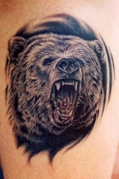 Realistic black roaring bear tattoo