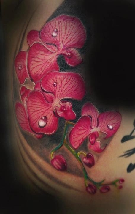 Realistic branch of red orchid with drops of dew tattoo