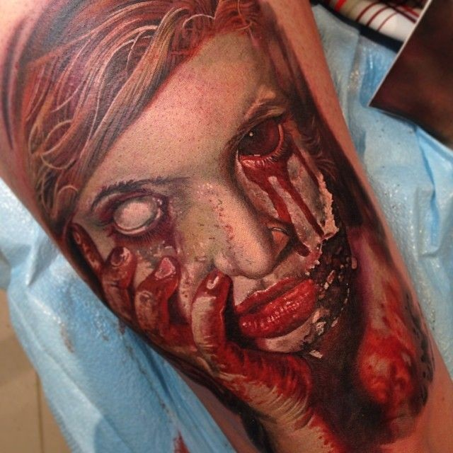 Realistic colored horror style bloody monster woman face tattoo