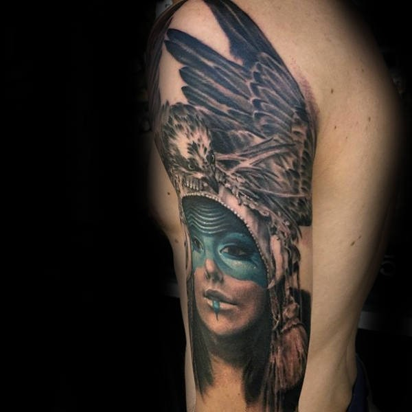 Realistic combined colored creative upper arm tattoo of ancient woman with eagle shaped helmet