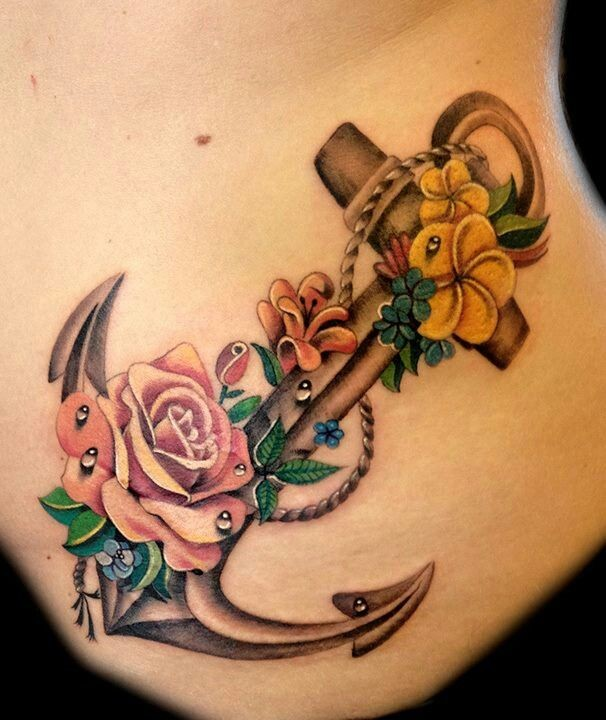 Realistic detailed anchor with roses tattoo on ribs