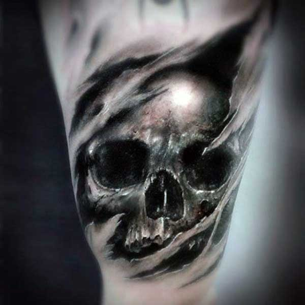 Realistic detailed and colored little skull tattoo on arm